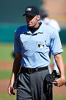 Home plate umpire Travis Carlson during an Arizona Fall League game between the Scottsdale Scorpions and Surprise Saguaros at Scottsdale Stadium on October 16, 2012 in Scottsdale, Arizona.  Surprise defeated Scottsdale 11-3.  (Mike Janes/Four Seam Images)