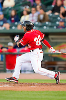 Jesmuel Valentin (22) of the Great Lakes Loons follows through on his swing against the Wisconsin Timber Rattlers at the Dow Diamond on May 4, 2013 in Midland, Michigan.  The Timber Rattlers defeated the Loons 6-4.  (Brian Westerholt/Four Seam Images)