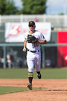 Surprise Saguaros left fielder Bryan Reynolds (10), of the Pittsburgh Pirates organization, jogs off the field between innings of an Arizona Fall League game against the Peoria Javelinas at Surprise Stadium on October 17, 2018 in Surprise, Arizona. (Zachary Lucy/Four Seam Images)