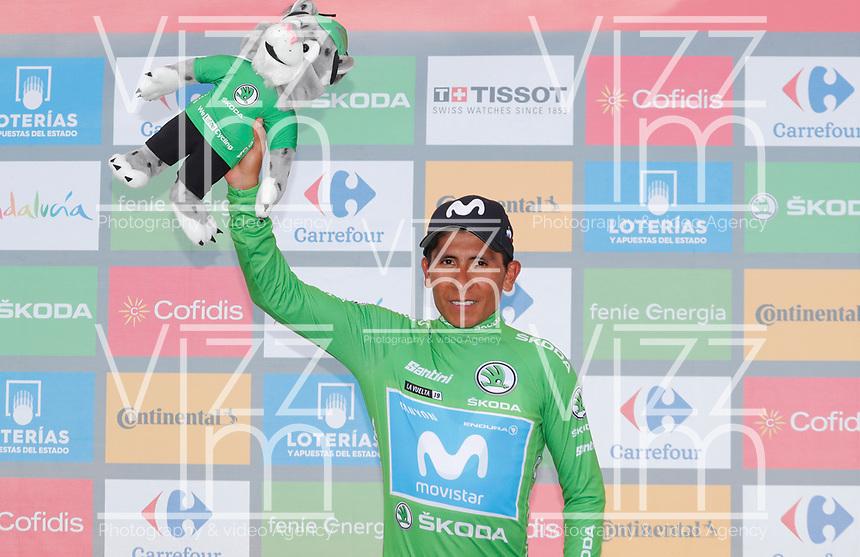 ESPAÑA, 30-08-2019: Nairo Quintana (ESP - MOVISTAR) celebra con maillot verde líder de los puntos después de la etapa 7, hoy, 30 de agosto de 2019, que se corrió entre Onda y Mas de la Costa con una distancia de 183,2 km como parte de La Vuelta a España 2019 que se disputa entre el 24/08 y el 15/09/2019 en territorio Español. / Nairo Quintana (ESP - MOVISTAR) celebrates with the green points leader jersey after the stage 7 today, August 30, 2019, from Onda to Mas de la Costa with a distance of 183,2 km as part of Tour of Spain 2019 which takes place between 08/24 and 09/15/2019 in Spain.  Photo: VizzorImage / Luis Angel Gomez / ASO<br /> VizzorImage PROVIDES THE ACCESS TO THIS PHOTOGRAPH ONLY AS A PRESS AND EDITORIAL SERVICE AND NOT IS THE OWNER OF COPYRIGHT; ANOTHER USE HAVE ADDITIONAL PERMITS AND IS  REPONSABILITY OF THE END USER