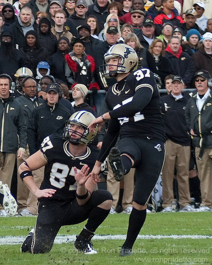 Purdue kicker Carson Wiggs kicks a field goal as the holder Kris Staats watches. The Purdue Boilermakers defeated the Ohio State Buckeyes 26-18 at Ross-Ade Stadium, West Lafayette, Indiana on October 17, 2009..