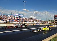 Jul. 23, 2011; Morrison, CO, USA: NHRA top fuel dragster driver Morgan Lucas (right) alongside Larry Dixon during qualifying for the Mile High Nationals at Bandimere Speedway. Mandatory Credit: Mark J. Rebilas-