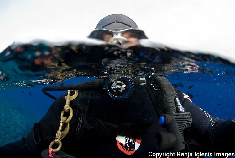 Half and Half photo of diver with sherwood SR 1 regulator Molokini Maui Hawaii.