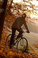Dave Seldon.riding Kona Hybrid bike in Autumn leaves.sunningdale , Berks Nov 2003.pic copyright Steve Behr / Stockfile