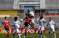 Roberto Lopez (12) of Honduras punches the ball away as teammate Cesar Yearwood (3) and Ismail Benomar (4) of Canada try to get a head on it during the group stage of the CONCACAF Men's Under 17 Championship at Catherine Hall Stadium in Montego Bay, Jamaica. Canada tied Honduras, 0-0.