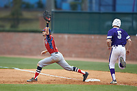 NJIT Highlanders first baseman Michael Anastasia (9) stretches for a throw as Austen Zente (5) of the High Point Panthers hustles down the line at Williard Stadium on February 18, 2017 in High Point, North Carolina. The Highlanders defeated the Panthers 4-2 in game two of a double-header. (Brian Westerholt/Four Seam Images)