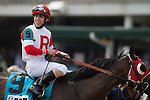 LOUISVILLE, KY - MAY 07: Irad Ortiz Jr., aboard Camelot Kitten #9, looks at the official results after winning the American Turf (Photo by Zoe Metz/Eclipse Sportswire/Getty Images)