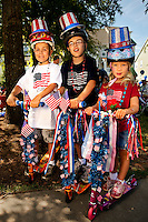 07/04/09 -  Photography of the annual Fourth of July Celebration and community parade in Birkdale Village in Huntersville, NC, a suburban community north of Charlotte, North Carolina. Birkdale Village combines shopping, dining, apartments and entertainment venues within a 52-acre mixed-use development. Each Independence Day, families gather their children and pets to participate in the popular July 4th community parade. The event includes a firefighter water fight, in which neighboring fire stations blast a large ball (strung on a wire) into the opposing team's area. Charlotte event photographer Patrick Schneider has additional Birkdale Village Fourth of July photos available at http://pa.photoshelter.com/c/patrickschneider/gallery/July-4th-celebrations/G0000CXKFlHTylqk/.