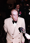 Vincente Minnelli, with Ron Galella in the background, attending the  Liza Minnelli and Mark Gero Wedding on December 4, 1979 at St. Bartholomew Church in New York City.