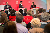 Labour party supporter.  Ed Miliband, Ed Balls, Rachel Reeves.  Labour Party election press conference, RIBA, London.