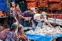 Chichicastenango, Guatemala.  Men Selecting Chalk, used for Whitewash, or in Tortillas.