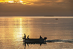 Heading out to fish at sunset on the lagoon in Tuvalu.