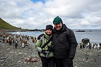 Michael and Elyn Stubblefield at a King Penguin (Aptenodytes patagonicus) colony at Sandy Bay, Macquarie Island, Australia.