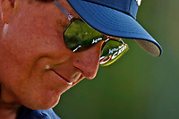 3rd July 2021, Detroit, MI, USA;  Phil Mickelson has the Rocket Mortgage logo reflect off his sunglasses as he walks the 9th hole on July 3, 2021 during the Rocket Mortgage Classic at the Detroit Golf Club in Detroit, Michigan.