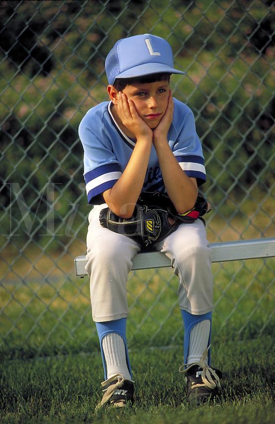 Little League boy on bench