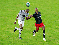 WASHINGTON, DC - NOVEMBER 8: Rod Fanni #7 of the Montreal Impact tries to head the ball away from Ola Kamara #9 of D.C. United during a game between Montreal Impact and D.C. United at Audi Field on November 8, 2020 in Washington, DC.