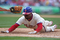Philadelphia Phillies shortstop Jimmy Rollins #11 dives back to first during their home opener against the Miami Marlins at Citizens Bank Park on April 9, 2012 in Philadelphia, Pennsylvania.  Miami defeated Philadelphia 6-2.  (Mike Janes/Four Seam Images)