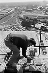 Irish labourers construction workers working on a Nine Elms tower block. South London skyline a England 1974