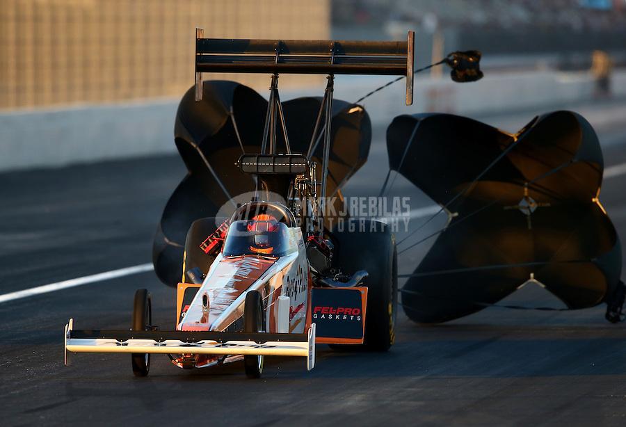 Nov 9, 2013; Pomona, CA, USA; NHRA top fuel dragster driver Clay Millican during qualifying for the Auto Club Finals at Auto Club Raceway at Pomona. Mandatory Credit: Mark J. Rebilas-