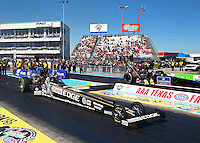 Sept. 22, 2013; Ennis, TX, USA: NHRA top fuel dragster driver Brittany Force (near lane) races alongside David Grubnic during the Fall Nationals at the Texas Motorplex. Mandatory Credit: Mark J. Rebilas-