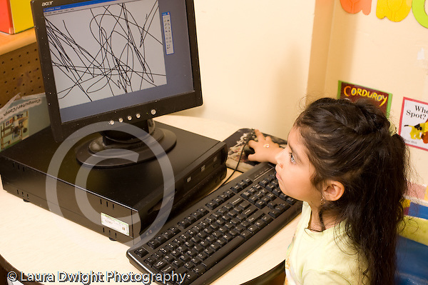 Preschool ages 3-5 girl using computer to draw on screen horizontal