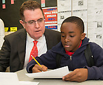 Houston ISD superintendent Dr. Terry Grier talks with a student during a Broad Foundation research team tour Ortiz Middle School, May 29, 2013.