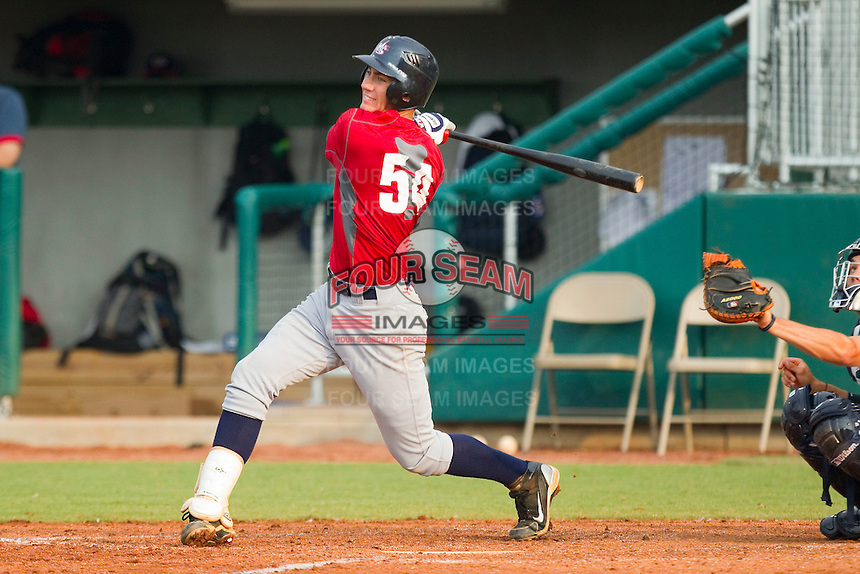 Nicky Delmonico #54 of Team Red follows through on his swing against Team Blue during the USA Baseball 18U National Team Trials at the USA Baseball National Training Center on June 30, 2010, in Cary, North Carolina.  Photo by Brian Westerholt / Four Seam Images