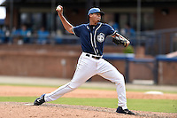 Asheville Tourists pitcher Salvador Justo (38) delivers a pitch during a game against the Hagerstown Suns and the  at McCormick Field on September 5, 2016 in Asheville, North Carolina. The Suns defeated the Tourists 9-5. (Tony Farlow/Four Seam Images)