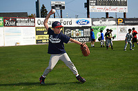Batavia Muckdogs youth baseball clinic participant throws the ball after fielding a fly ball during the outfield station on August 30, 2017 at Dwyer Stadium in Batavia, New York.  (Mike Janes/Four Seam Images)