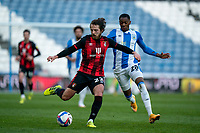 13th April 2021; The John Smiths Stadium, Huddersfield, Yorkshire, England; English Football League Championship Football, Huddersfield Town versus Bournemouth; Ben Pearson of Bournemouth taking the ball past Jaden Brown of Huddersfield Town