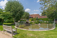 BNPS.co.uk (01202 558833)<br /> Pic: Mullucks/BNPS<br /> <br /> Pictured: The new owners will be free to enjoy the estate's communal grounds. <br /> <br /> Time for a change...<br /> <br /> A former granary with an impressive clock tower on top is on the market for £1.45m.<br /> <br /> The new owners of the aptly-named The Clockhouse will have a tall order adjusting this timepiece when the clocks go back at the end of October.<br /> <br /> The Grade II listed property has a 10ft central wooden clock tower which is believed to date back to the construction of the original granary building in the Georgian era.