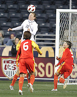 Abby Wambach #20 of the USA WNT leaps high above Na Zhang #6 of the PRC WNT during an international friendly match at PPL Park, on October 6 2010 in Chester, PA. The game ended in a 1-1 tie.