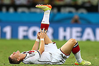 Bastian Schweinsteiger of Germany feels the pain from an injury
