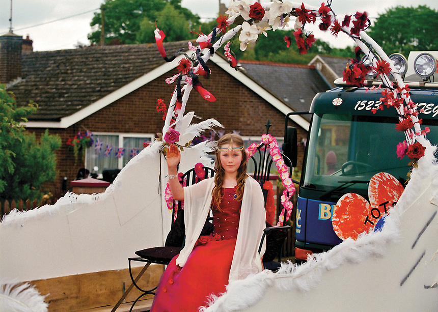 """May Queen of Northwold, Tegan Wellard. <br /> <br /> """"Joining in the ancient tradition, with tea and cake on the lawns, families watched on as the children performed the traditional May Day dances they had been preparing in school."""""""