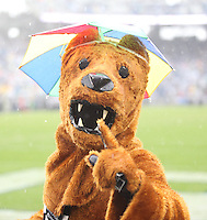 State College, PA - 09/12/2015:  The Nittany Lion mascot was wearing an umbrella hat for parts of the wet and dreary game against Buffalo. Penn State defeated Buffalo by a score of 27-14 at rainy Beaver Stadium in University Park, PA.<br /> <br /> Photos by Joe Rokita / JoeRokita.com