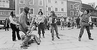 The York Street Band playing in York, March 1979.  Dena Attar on saxophone, Sarah Kemp on washboard, then the three members of the YSB: Sarha Moore (sticks), Anthea Gomez (accordian) and Ros Davies (tambourine).  Sarha Moore and Ros Davies went on to play in The Bollywood Band, and Ros also joined the Grand Union Band, in London.  Anthea Gomez went on to write and play music for the theatre and then BBC Drama before changing direction.