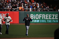 SAN FRANCISCO, CA - SEPTEMBER 29:  Dodgers manager Dave Roberts laughs after Barry Bonds threw his cap during a ceremony celebrating the career of manager Bruce Bochy after the game between the Los Angeles Dodgers and the San Francisco Giants at Oracle Park on Sunday, September 29, 2019 in San Francisco, California. (Photo by Brad Mangin)