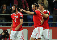 Gareth Bale of Wales (C) with team mates Joe Ledley (L) and Sam Vokes (R) celebrates his opening goal during the 2018 FIFA World Cup Qualifier between Wales and Serbia at the Cardiff City Stadium, Wales, UK. Saturday 12 November 2016