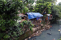 Slums next to a polluted waterway in central Jakarta.<br /> <br /> To license this image, please contact the National Geographic Creative Collection:<br /> <br /> Image ID: 1588002 <br />  <br /> Email: natgeocreative@ngs.org<br /> <br /> Telephone: 202 857 7537 / Toll Free 800 434 2244<br /> <br /> National Geographic Creative<br /> 1145 17th St NW, Washington DC 20036