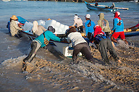 Jimbaran, Bali, Indonesia.  Launching Boat Carrying Ice to Offshore Fishing Boats.