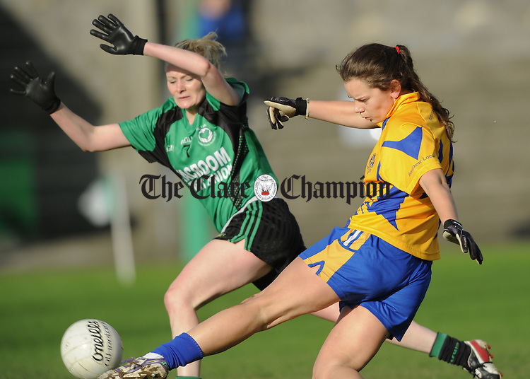 Niamh O Dea of The Banner in action against Vera Foley of St Valentine's during their Senior Ladies Munster football final at Kilmallock. Photograph by John Kelly.
