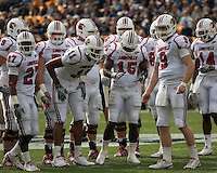 The Louisville offense huddles before the next play. The Pitt Panthers defeated the Louisville Cardinals 20-3 at Heinz Field, Pittsburgh Pennsylvania on October 30, 2010.
