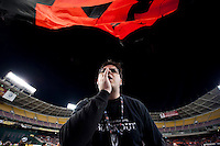 A member of the D.C. United's supporters club, Barra Brava, leads a chant before the game at RFK Stadium in Washington DC. D.C. United tied New York Red Bulls, 1-1.