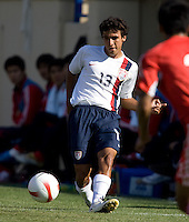 Jonathan Bornstein slides a pass. The USA defeated China, 4-1, in an international friendly at Spartan Stadium, San Jose, CA on June 2, 2007.