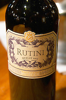 Bottle and glass on a wooden bar counter of Rutini Merlot 2002, Bodega La Rural, Maipu, Mendoza The Rosa Negra Restaurant, The Black Rose, Buenos Aires Argentina, South America San Felipe, La Rural Vinedos y Bodegas Winery