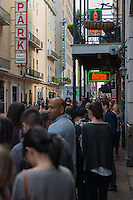 People standing in line at Acme Oyster Bar on Iberville Street, New Orleans, Louisiana