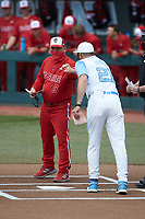 North Carolina State Wolfpack head coach Elliott Avent bumps fists with North Carolina Tar Heels head coach Scott Forbes prior to their NCAA baseball game at Boshamer Stadium on March 27, 2021 in Chapel Hill, North Carolina. (Brian Westerholt/Four Seam Images)