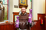 Fr Anthony Jukes with the Holy water they are giving out in the Friary in Killarney