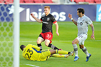 WASHINGTON, DC - NOVEMBER 8: Clement Diop #23 of Montreal Impact saves a shot on goal against Julian Gressel #31 of D.C. United during a game between Montreal Impact and D.C. United at Audi Field on November 8, 2020 in Washington, DC.