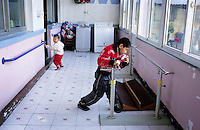 CHINA. Beijing. Young orphans in an orphanage outside of Beijing. 2007. There are currently millions of orphans in China living in orphanages spread throughout the country. As a result of China's one-child policy, many children are abandoned or given up if they suffer from any physical or mental handicap as the parents strive to have a child born 'normal' and well. This has led to may children being abandoned to live in state and privately-owned orphanages.